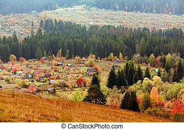 Beautiful autumn mountain and the village on mountainside