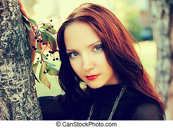 Beautiful autumn portrait of young girl