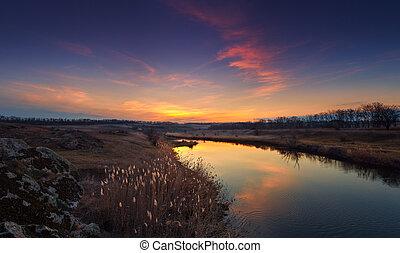 Beautiful autumn sunset on the river