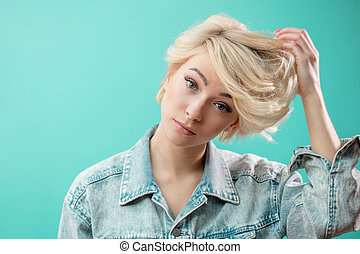 Beautiful awesome model with short blond hair looking at the camera