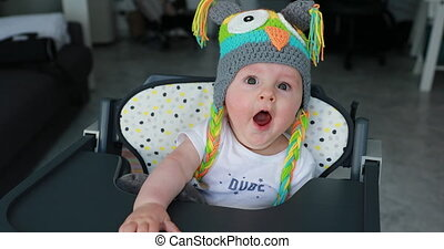 Beautiful Baby Boy With A Funny Wool Hat On The Head