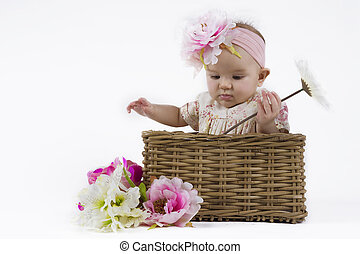 beautiful baby girl in a basket