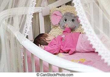 Beautiful baby girl in pink