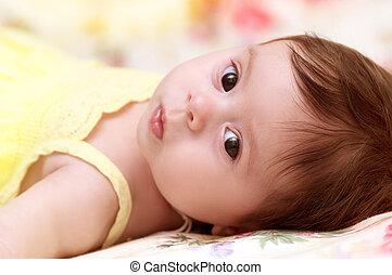Beautiful baby girl in yellow
