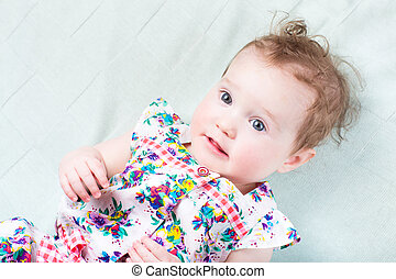 Beautiful baby girl with big blue eyes