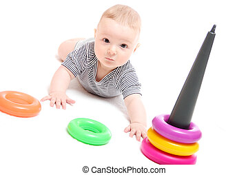 Beautiful baby playing with toys