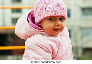 Beautiful baby portrait outdoor in playground