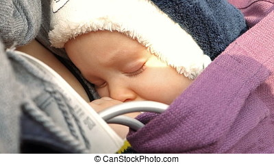 Beautiful baby sleeping in mother arms