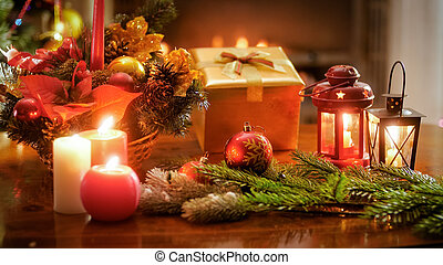 Beautiful backgorund for winter celebrations with Christmas tree, gifts and candles