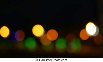 Beautiful background: blurred city life. Colorful circular...