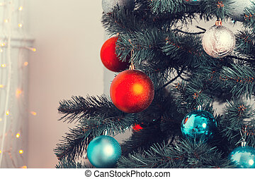 Beautiful background decorated Christmas tree with toy balls and garlands. The idea for postcards. Soft focus. Shallow DOF