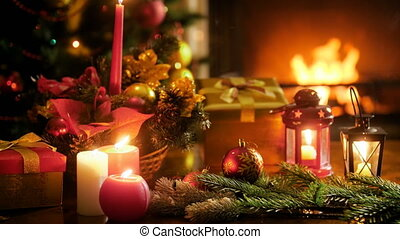 Beautiful background for winter celebrations of burning fireplace, decorated Christmas tree and traditional ornaments