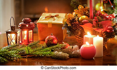 Beautiful background for winter holidays with gift box, traditional wreath and Christmas decorations