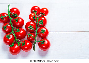 Beautiful background healthy organic a branch cherry tomatoes  on the white boards with free space for you text