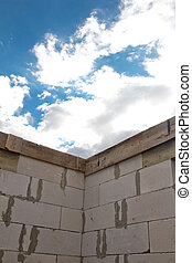 beautiful background of a brick wall and sky with clouds