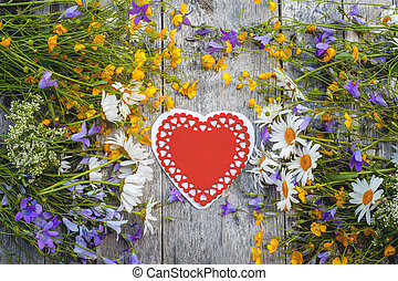 Beautiful background of flowers field of daisies and bells and hearts for Valentine's Day. Copy space.