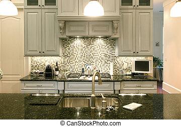 beautiful kitchen with glass backsplash and granite counter