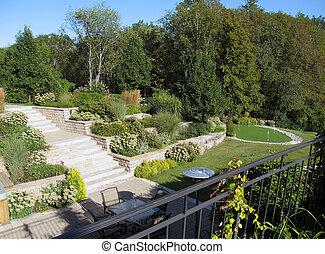 Beautiful backyard landscape - A section of the backyard of...