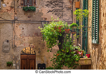 Beautiful balcony decorated with flowers in italy