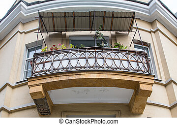 Balcony on the corner of an old house