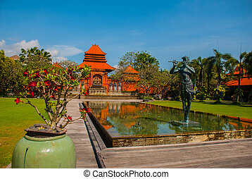 Beautiful Balinese building with a fountain and...