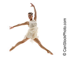Beautiful ballerina posing in graceful leap
