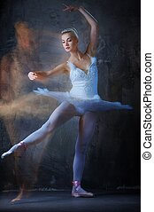 Beautiful ballet dancer in motion.