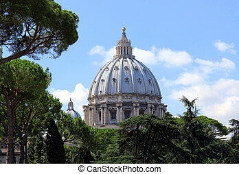 Beautiful basilica surrounded by trees and the blue sky.