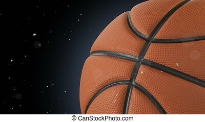 Beautiful Basketball Ball Rotating Close-up in Slow Motion on Black with Dust Particles Flying. Looped Basketball 3d Animation of Turning Ball. 4k UHD