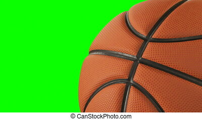 Beautiful Basketball Ball Rotating Close-up in Slow Motion on Green Screen. Looped Basketball 3d Animation of Turning Ball. 4k Ultra HD 3840x2160.