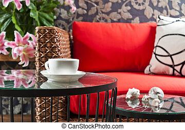 Beautiful basketwork furniture in front of gobelin