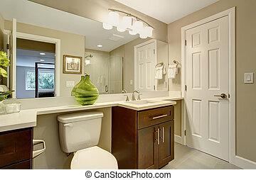 Beautiful bathroom with green vase.