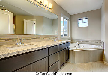 Beautiful bathroom with large bathtub.