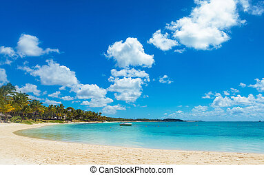 beautiful bay in mauritius island with speed boat in sunny...