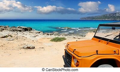 beautiful beach with convertible car in ibiza with turquoise water background