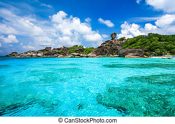 Beautiful beach and crystal clear sea at tropical island,...