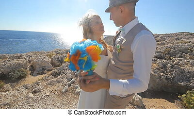 Beautiful beach marriage. the bride and groom against the blue sea