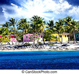 Beautiful beach of caribbean island with brilliant red, pink and yellow homes, Santo Domingo