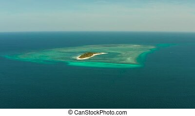 Tropical island Canimeran with sandy beach in the blue sea with coral reef, top view. Summer and travel vacation concept. Balabac, Palawan, Philippines.