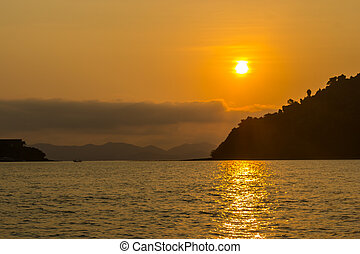 Beautiful beach sunrise over the sea or ocean island in phuket, Thailand