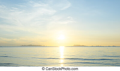 Beautiful beach sunrise with blue sea and golden light sky cloud background