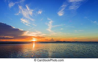 Beautiful beach sunset with big rain clouds and golden light...