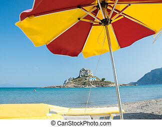 Beautiful beach umbrella with view on Kastri Island, Kos