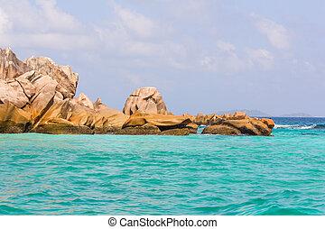 Beautiful beach with big rock and tree