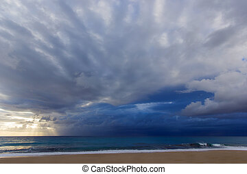 beautiful beach with clouds and sunset