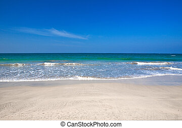 Beautiful beach with crystal clear blue waters the sea against blue sky .