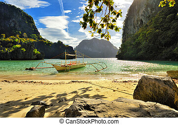 Beautiful beach with rocks on the background of the islands. El Nido, Philippines