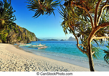 Beautiful beach with rocks on the background of the islands