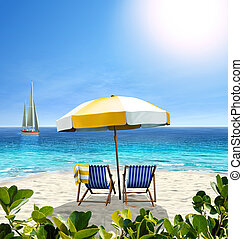 Beautiful beach with white sand, two chairs, white-yellow umbrella and a sailing boat in the sea.