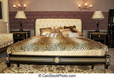Beautiful bedroom with huge bed and a leopard blanket
